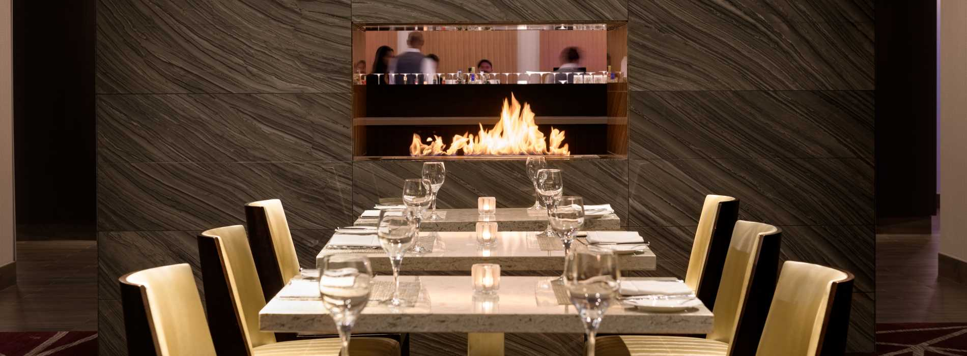 Evening Photo of Table and Fireplace