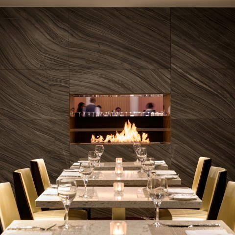 Communal Table located adjacent to the fireplace at L'Enfant Bar and Grill